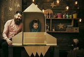 Child Dreams. Rocket Launch Concept. Kid Happy Sit In Cardboard Hand Made Rocket. Boy Play With Dad, poster