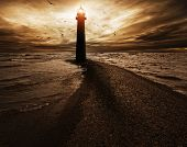 picture of lighthouse  - Stormy sky over  lighthouse - JPG