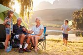 Grandchildren With Grandparents On Camping Holiday By Lake poster