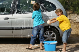 stock photo of car wash  - children helping with chores washing family car - JPG