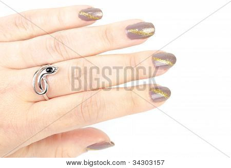 Woman's Hand With  Manicure and Silver Snake Ring.