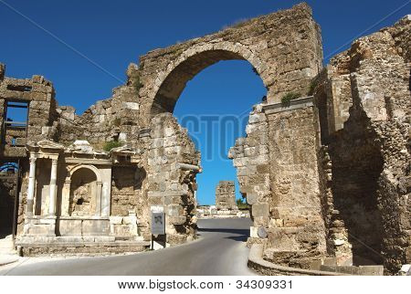 Road and ancient ruins in Side, Turkey