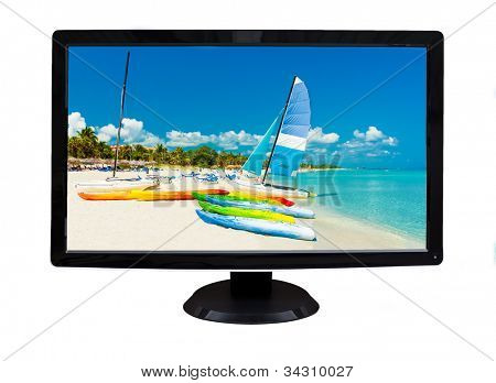 TV or computer monitor showing an image of a tropical beach and sailing boats  (isolated on white)