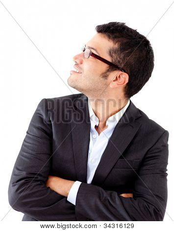Businessman looking up and wearing glasses - isolated over a white background