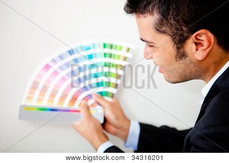 Interior designer with color palette ready to decorate