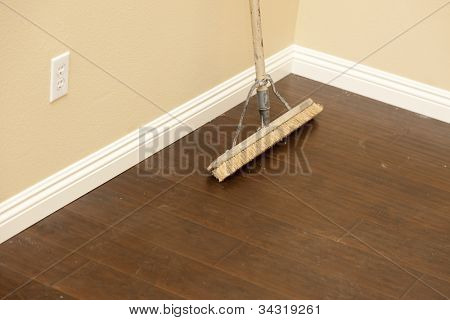 Push Broom on a Newly Installed Laminate Floor and New Baseboards.