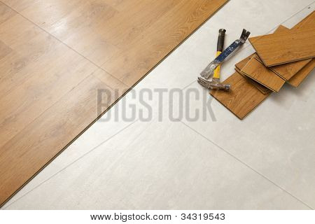 Worn Hammer and Pry Bar with Laminate Flooring Abstract with Copy Room.