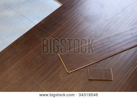 Newly Installed Brown Laminate Flooring Abstract.
