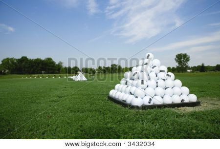 Pyramid Of Golf Balls On The Practice Tee