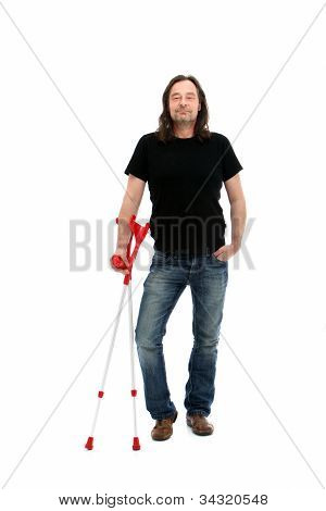 Injured Middle-aged Man With Crutches