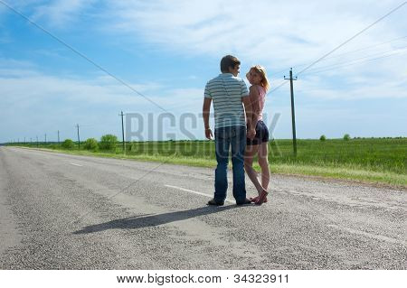 The Young Couple Costs On The Road