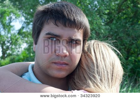 The Guy Embraces The Girl