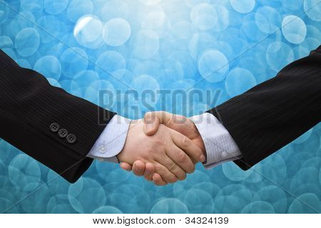 Handshake with blue abstract background