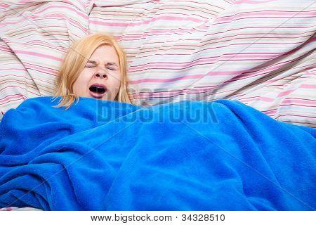 Sleepy Woman Yawn In A Duvet