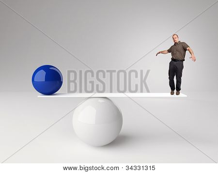 3d image of ball and man  in false balance