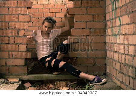 Girl In Torn Clothes Inside Ruins