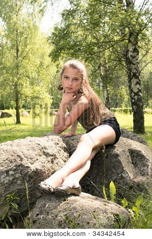 Girl Sitting On The Stone