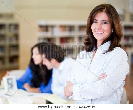 Woman at the library working as a librarian