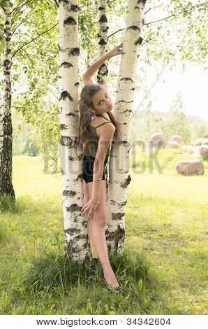 Girl Looking Throw Birches