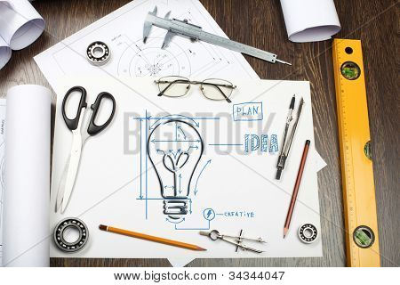 Tools and papers on the table with industrial symbols