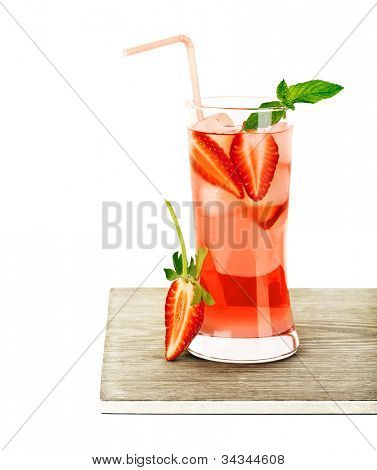 Red fruity strawberry cocktail with mint, cold drink isolated over white background, refreshing summer beverage, glass of fresh juice on wooden table, tasty diet, food style and design