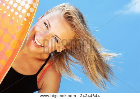 Happy surfer beautiful teen girl laughing, pretty female holds bodyboard, young healthy woman playing surf sport, big smile facial expression, summer outdoor beach leisure fun and vacation