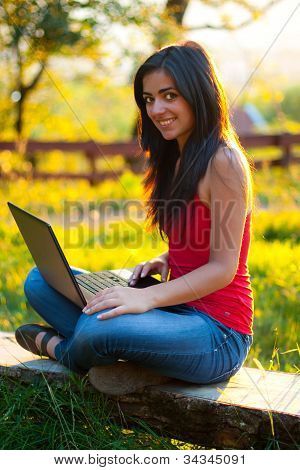Beautiful Girl With Her Laptop Outdoors