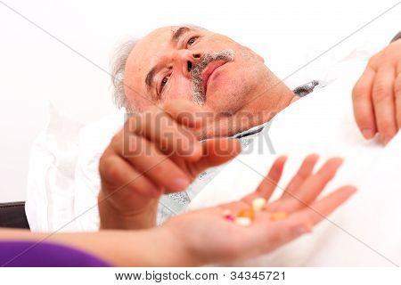 Sick Man Taking Pills