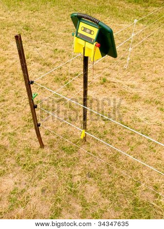 Electric livestock fence charger and fencing