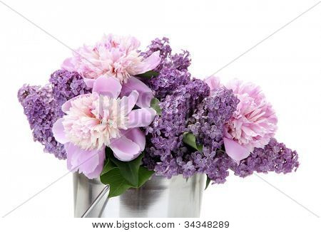 beautiful lilac and peonies flowers in metal bucket isolated on white