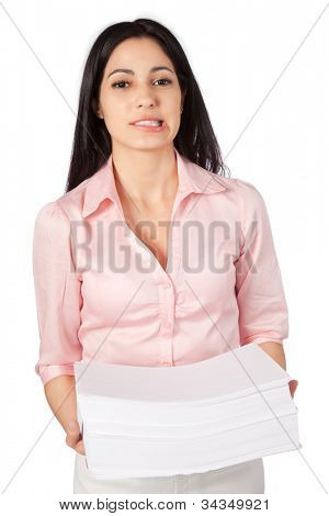 Woman holding a big pile of paper work isolated on white background.