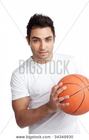 Portrait of young man holding basketball isolated on white background.