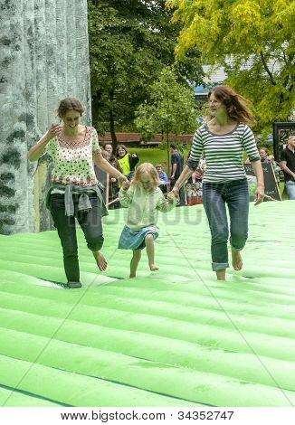 : A mother and child walk on the life-sized inflatable replica of Stonehenge