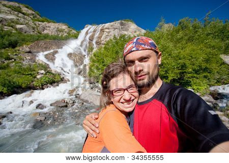Hikers In Caucasus Mountains Near Waterfall