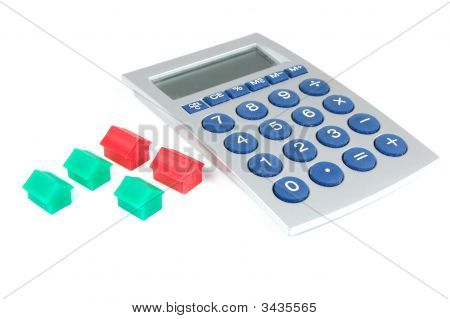 Houses And Calculator On White
