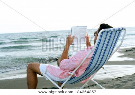 Young guy relaxing at the beach