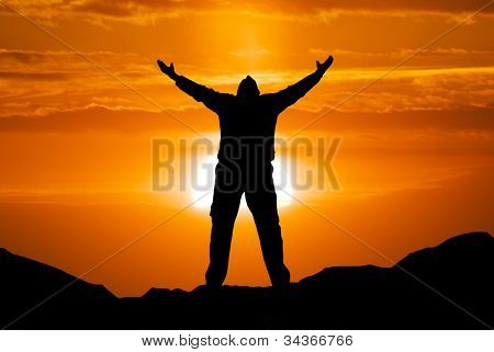 Silhouette of man and big sun. Conceptual scene.