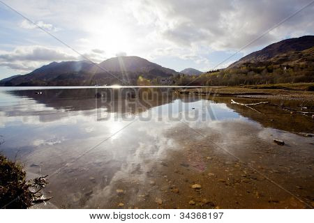 Sun Reflection of  Loch Shiel Lake at Glenn Finnan Highlands Scotland