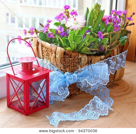 Floral Composition In A Small Basket  On A Balcony