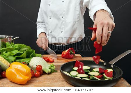 Chef Adding Ingredients
