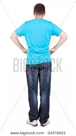Back view of young men in  blue t-shirt and jeans.  Guy  looks away. Rear view people collection.  backside view of person.  Isolated over white background.