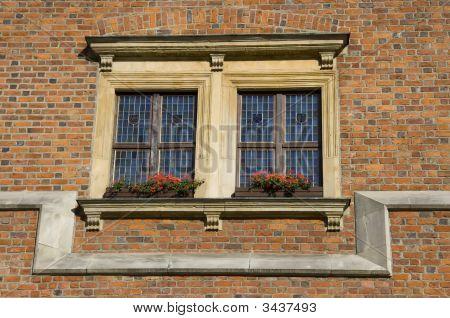 Double Window Over Red Brick Wall