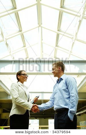 Business people shaking hands with a smile concluding a deal or greeting each other