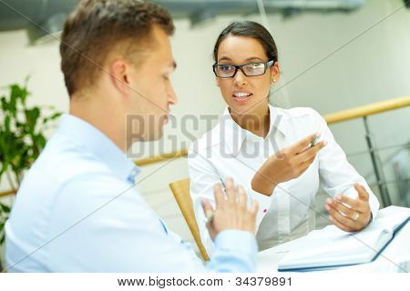 Disagreement occurring in the midst of the discussion between two business people