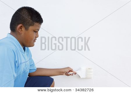 Boy Painting A Wall
