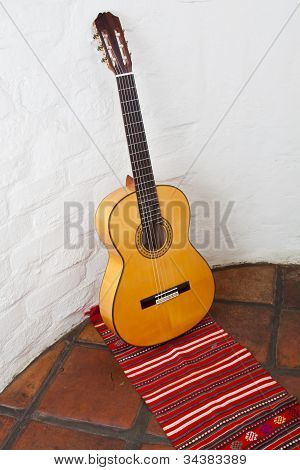 Guitar against a wall