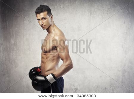 Profile of a muscular young boxer