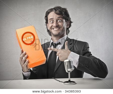 Smiling salesman advertising a product