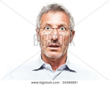 Surprised senior man portrait wearing a pair of glasses isolated on white background