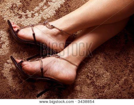 Woman's Feet In Sexy Shoes